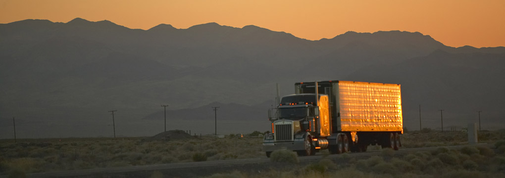 Temperature controlled truck with sunset in the background